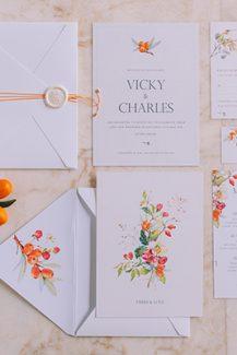 Προσκλήσεις γάμου με πορτοκαλί λεπτομέρειες