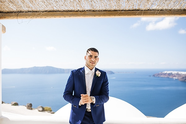 breathtaking-styled-shoot-board-magnificent-view-caldera-santorini-endless-blue-sea_08