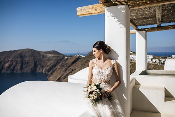 breathtaking-styled-shoot-board-magnificent-view-caldera-santorini-endless-blue-sea_09x