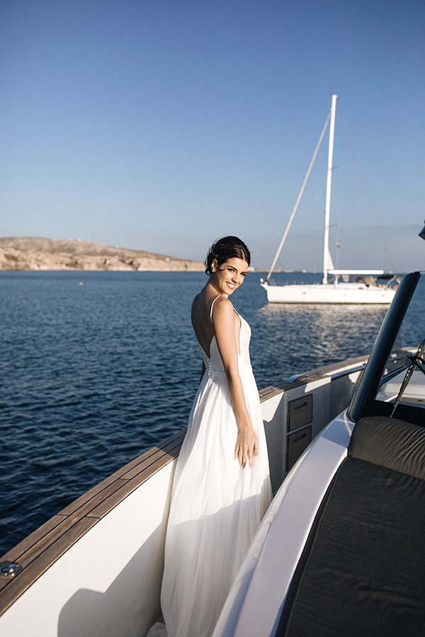 breathtaking-styled-shoot-board-magnificent-view-caldera-santorini-endless-blue-sea_13