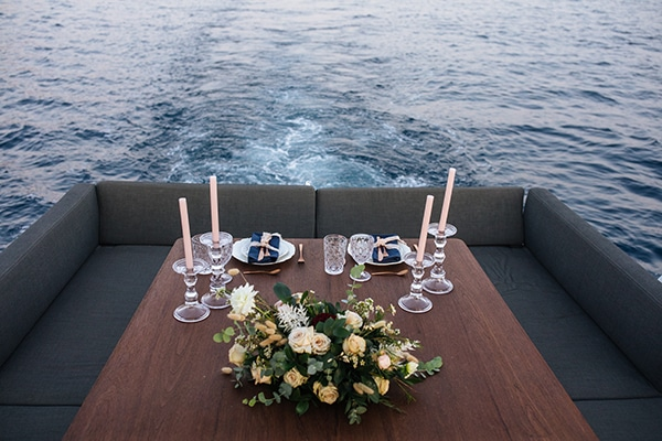 breathtaking-styled-shoot-board-magnificent-view-caldera-santorini-endless-blue-sea_18